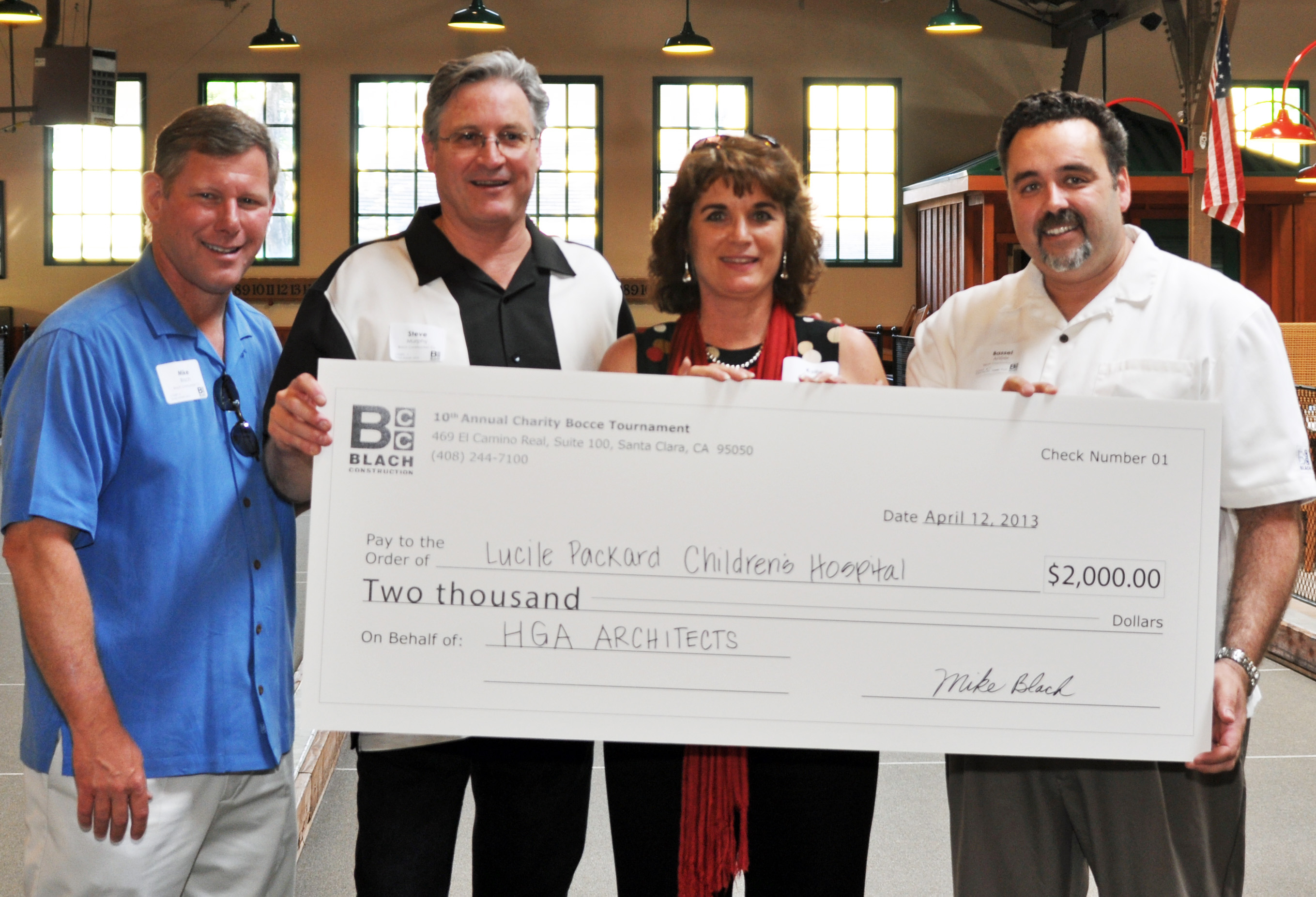 Charity Bocce Ball Tournament Mike Blach, Steve Murphy, Kelly Cardella and Bassel Anber Presenting Check